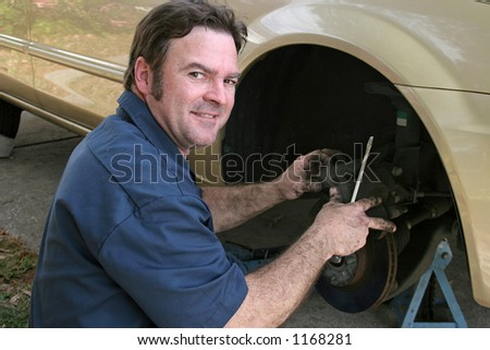 A shifty looking, dishonest mechanic taking advantage of you. - stock photo