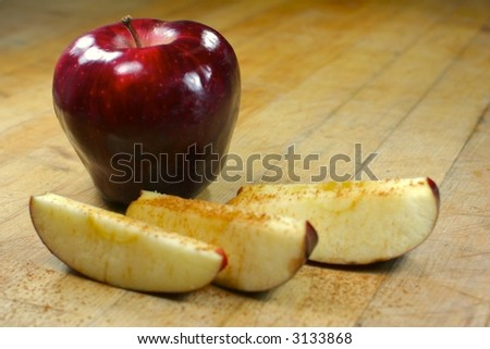 A shiny apple with cinnamon
