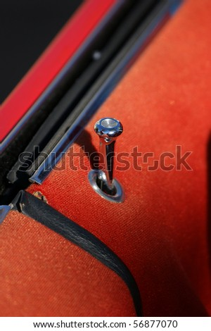A shiny chrome plunger on a restored classic car - stock photo