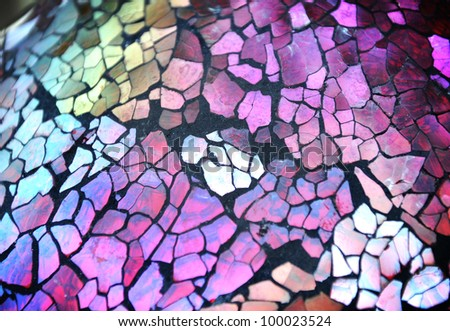 A shiny glass texture background with mosaic tile pieces that are very colorful.