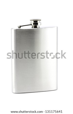 A shiny new, stainless steel drinking hip flask isolated on a white background with room for copy