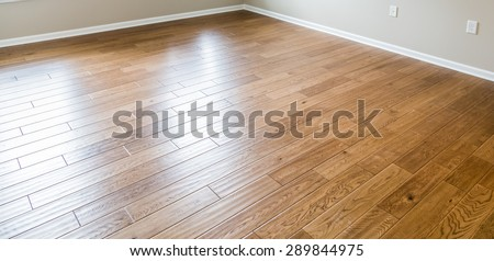 A shiny, polished hardwood floor in a new home - stock photo