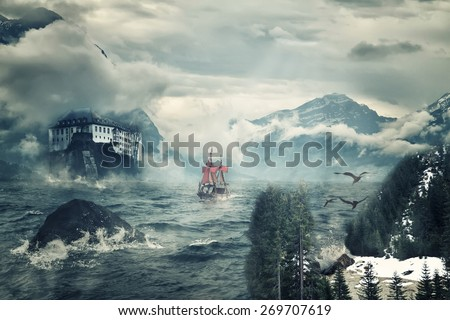 A ship in a wild stormy sea and a rock with a fortress. - stock photo