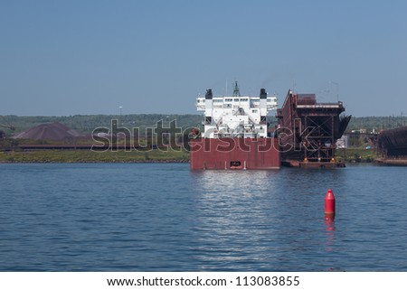 A ship next to a loading dock. - stock photo