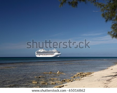 A ship waits on the horizon of Caribbean sea