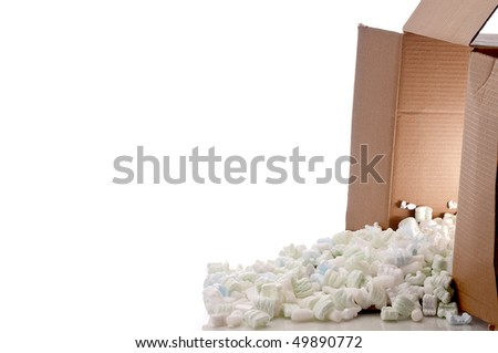 a shipping box with  a glow inside spilling peanuts on white - stock photo