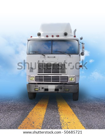 A shipping truck is on a road with the sky fading in the background. Can be used as a transportation, cargo or travel image for business and shipping goods. - stock photo