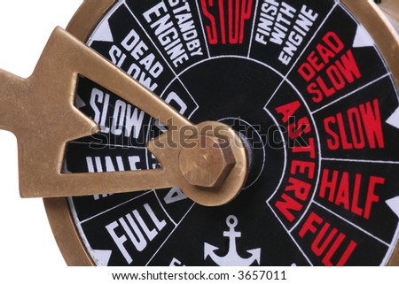 A ships telegraph set to the slow speed - stock photo