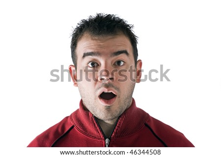 A shocked or surprised young man isolated over white. - stock photo