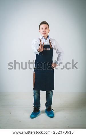 A shoot of young caucasian men in apron as a barmen. Isolated against white background. - stock photo