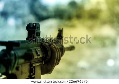 A shooter sighting in the target.  - stock photo