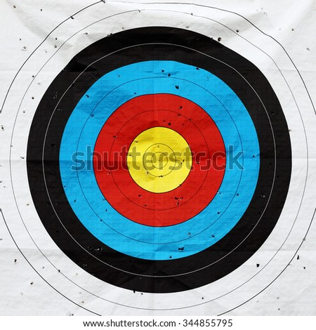 A shooting target paper peppered with bullet holes.  - stock photo