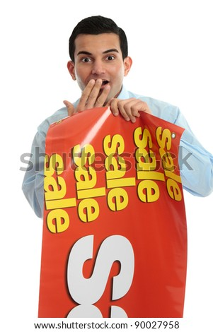 A shopkeeper holding a sale sign banner and showing a surprised look - stock photo