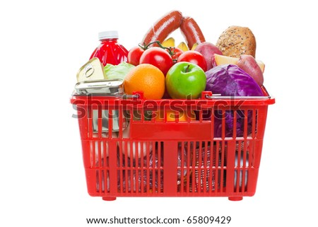 A shopping basket full of fresh colorful vegetables and fruit isolated on white background
