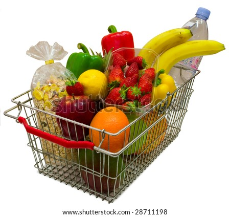 A shopping basket full of fresh colorful vegetables isolated on white background. - stock photo