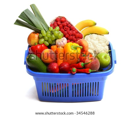A shopping basket full of fresh produce on white. - stock photo