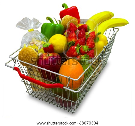 A shopping basket full of fresh vegetables isolated on white background.