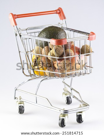 a shopping cart filled with fruit - stock photo