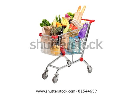 A shopping cart full with various groceries isolated on white background - stock photo