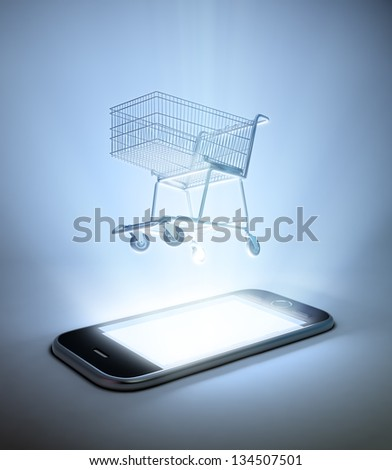 A shopping cart on  a smart phone - mobile commerce concept - stock photo