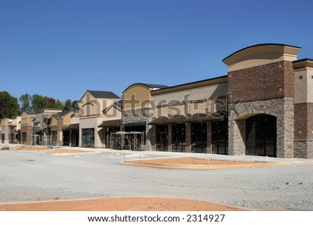 A shopping center under construction, made to appear like a small town street.