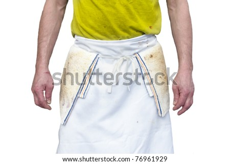 A short order cook wearing a dirty apron is seen showing his waist where the apron is tied. Horizontal shot. Isolated on white. - stock photo