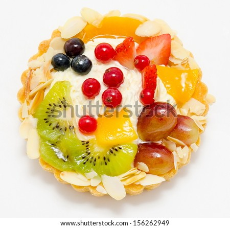 a short pastry basket filled with cream, fruit and berries - stock photo