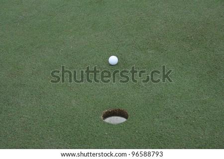 A short putt on a golf green - stock photo