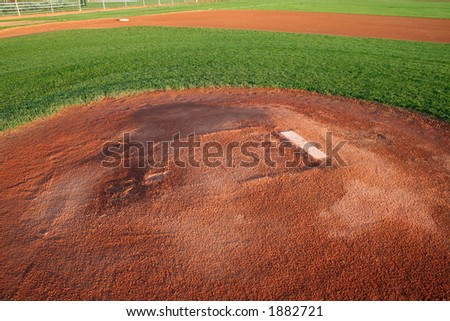 A shot of a baseball field from right behind the pitchers mound. - stock photo