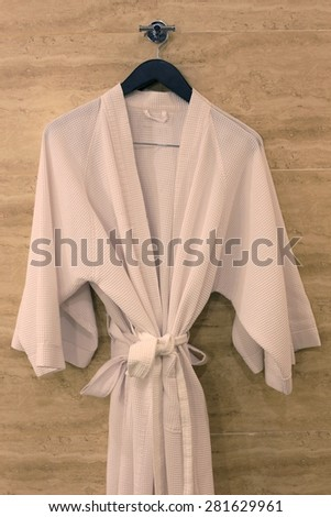 A shot of a bathrobe hanging in a bathroom - stock photo