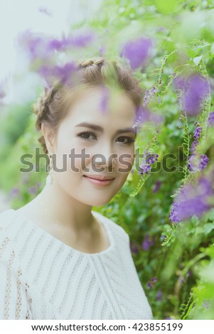 A shot of a beautiful asian woman outdoor, vintage color. - stock photo