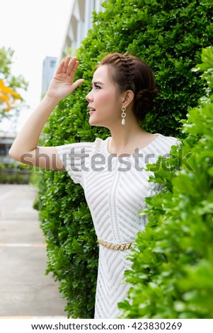 A shot of a beautiful asian woman outdoor with searching - stock photo