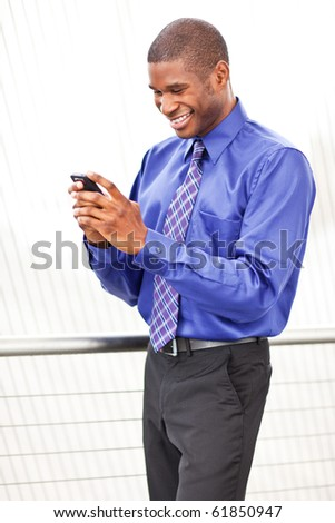 A shot of a beautiful black businesswoman texting - stock photo