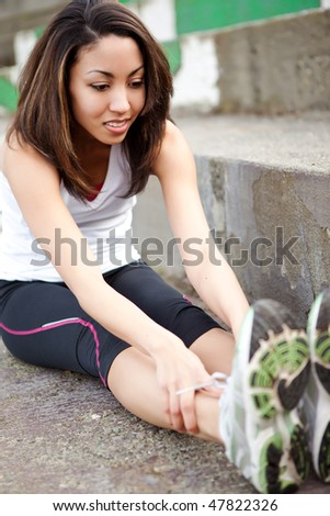 A shot of a beautiful black woman exercises outdoor