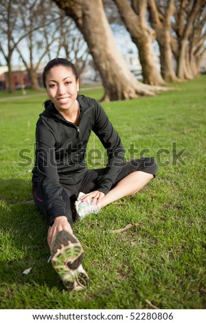 A shot of a beautiful black woman exercises outdoor - stock photo