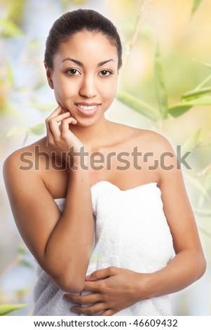 A shot of a beautiful black woman in the spa - stock photo