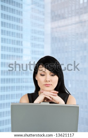 A shot of a beautiful businesswoman working on her laptop at the office - stock photo
