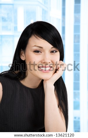 A shot of a beautiful smiling businesswoman in the office - stock photo