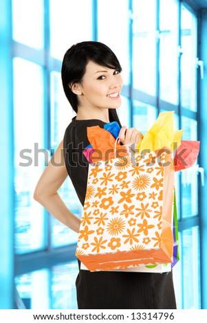 A shot of a beautiful woman carrying shopping bags - stock photo
