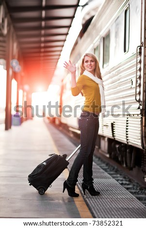 A shot of a beautiful young Caucasian woman traveling pulling a luggage