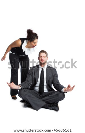 A shot of a black  businesswoman yelling at a meditating caucasian businessman - stock photo