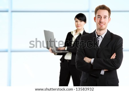 A shot of a businessman and businesswoman working in the office - stock photo