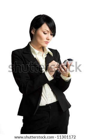 A shot of a businesswoman working on her PDA - stock photo