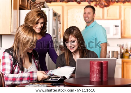 A shot of a caucasian family spending time at home - stock photo