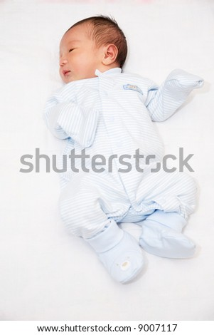 A shot of a cute asian baby boy - stock photo