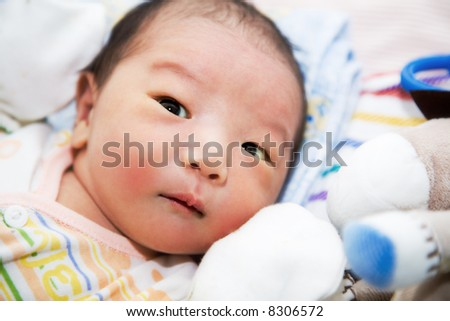 A shot of a cute baby boy - stock photo