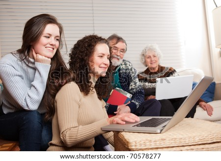 A shot of a family spending time at home with laptop