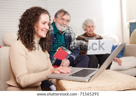 A shot of a family spending time at home with laptop - stock photo