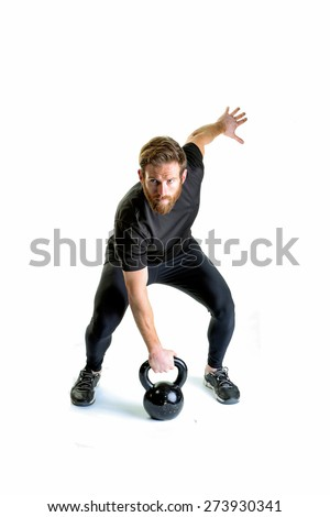 A shot of a fitness model lifting a kettle bell - stock photo