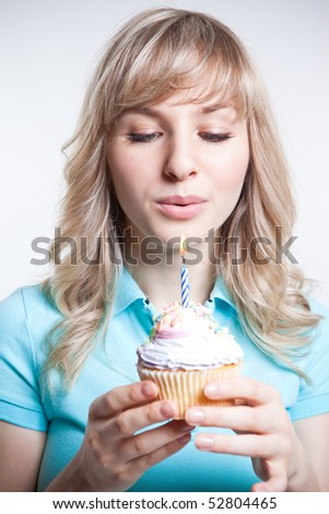 A shot of a girl celebrating her birthday blowing the candle - stock photo